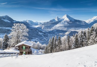 Idyllic winter landscape the Alps with traditional mountain chalet