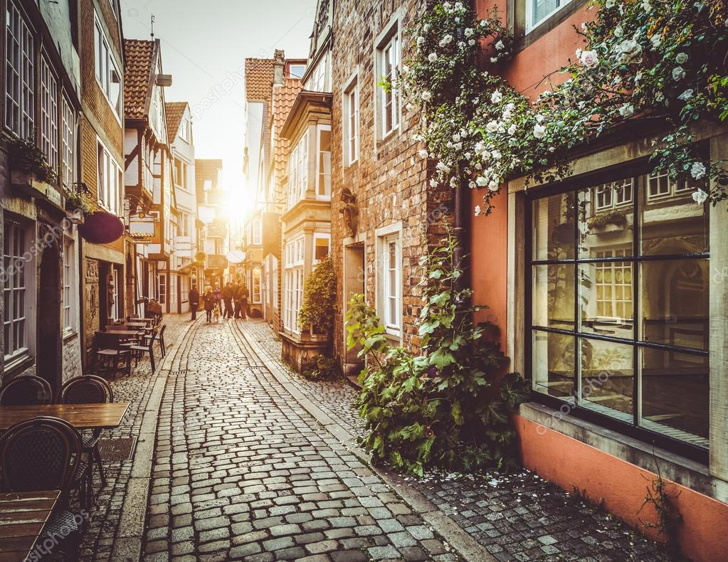 Фотообои Old town in Europe at sunset with retro vintage filter effect