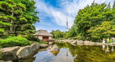 Japanese Garden (Planten un Blomen park) with Heinrich-Hertz-Turm, Hamburg, Germany