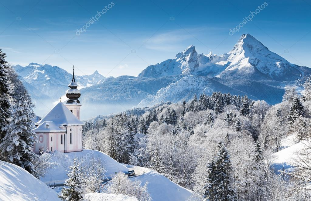 Idyllic winter landscape with chapel in the Alps