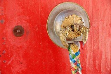 Brass dooknob on red door. Kelsang Phodrang-Norbulingka-Lhasa-Tibet. 1256