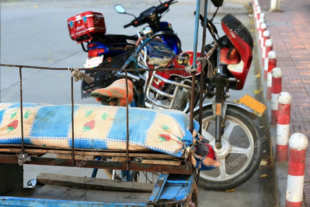 Cart and motorbikes. Gyantse-Tibet. 1591
