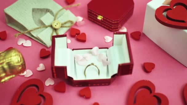 Red heart falling on gifts. Valentine concept