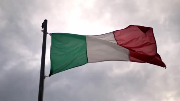 Italy flag waving in the wind, sky background