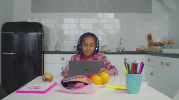 Positive little girl watching video on tablet pc