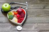 Photo Healthy food in heart and cholesterol diet concept on vintage boards