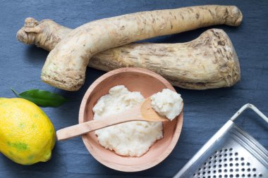 Raw horseradish and spices abstract still life