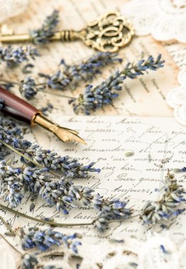 vintage ink pen, key, lavender flowers and old love letters