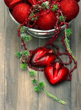 vintage christmas background with red baubles and hearts