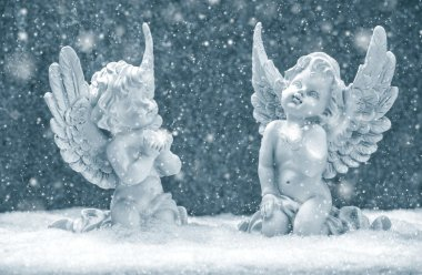 little guardian angels in snow. christmas decoration