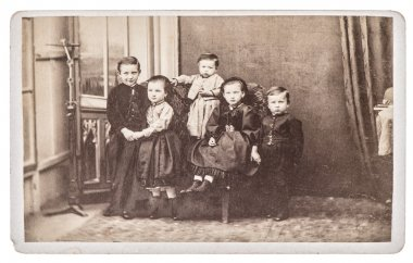 Old family photo with five children. brothers and sisters