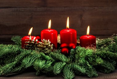 advent decoration with four red burning candles