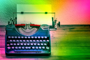 Vintage typewriter with color spot lights. Creativity concept