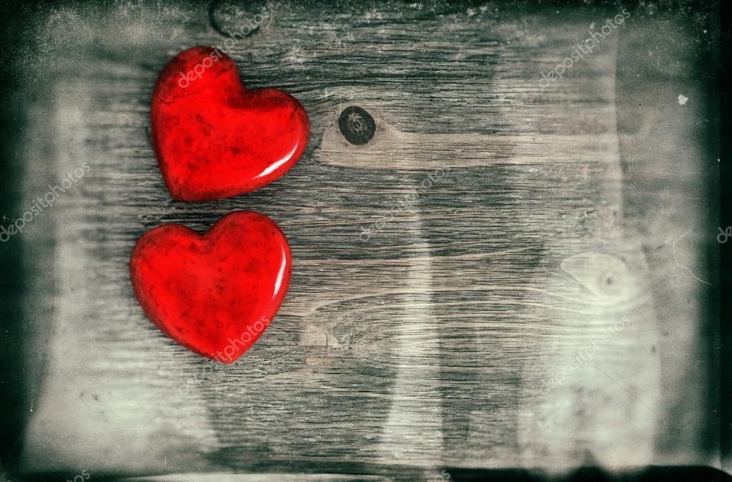 Red Hearts On Wooden Background. Valentines Day Concept. Vintage style toned picture with grunge effect stock vector