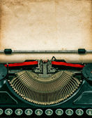 Fotografie Vintage typewriter with textured grungy paper