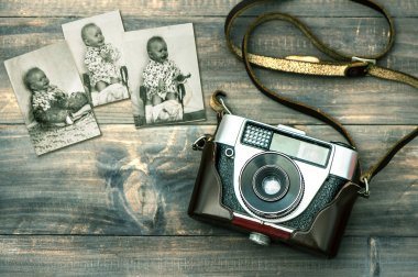 Vintage camera and old baby photos.