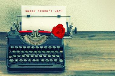 Text Happy Women's Day in  typewriter