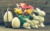 Fotografie Vintage decoration with tulip flowers, easter eggs and bunnies