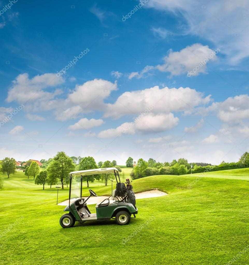 Golf cart on a golf course. Green field and cloudy blue sky — Stock Sky Golf Cart on sky candles, sky sunglasses, sky bags, sky wheels, sky games, sky comedy, sky cars, sky lifts,