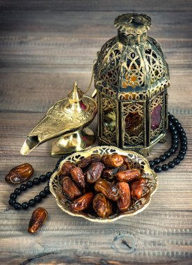 Dates, arabic lamps and rosary. Islamic holidays concept. Vintag