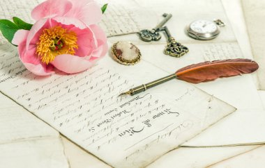 Old letters, pink peony flower and antique feather pen. Vintage