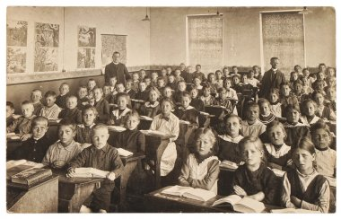 Retro picture of classmates. Group of children in the classroom