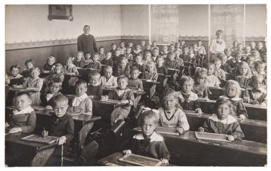 Children and teacher in the classroom. Back to school concept