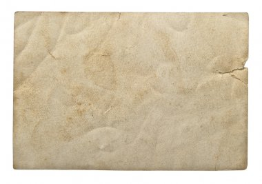Used paper sheet on white background. Grungy cardboard texture