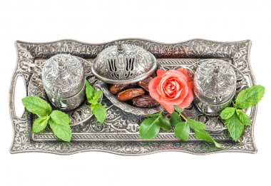 Holidays tea table setting with dates. Oriental hospitality