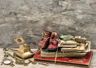 Antique books and photos, keys and writing accessories