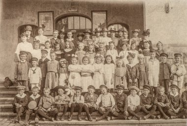 Antique portrait of school classmates. Children and teachers
