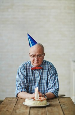 Senior man with birthday cake