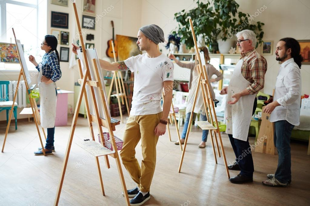students painting in workshop