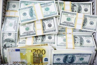 dollar bills and euro banknotes