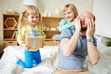 daughters congratulating father