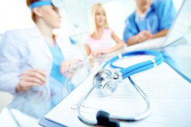 stethoscope on medical record