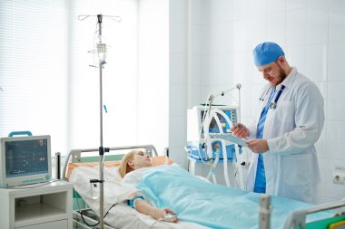 Weak woman on hospital bed
