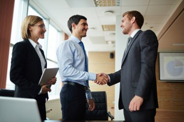 Men greeting after making business agreement