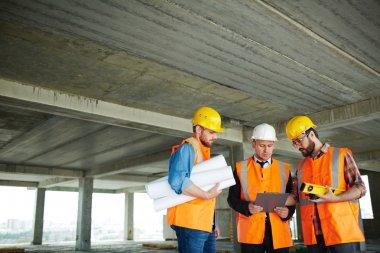 Inspectors on construction site