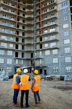 Inspectors looking at building construction
