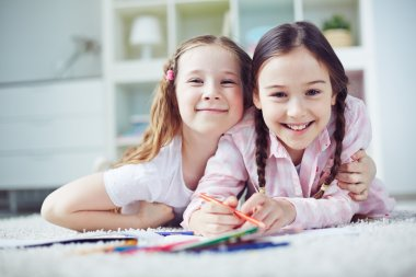 Two little girls drawing at leisure