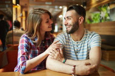 couple relaxing in cafe