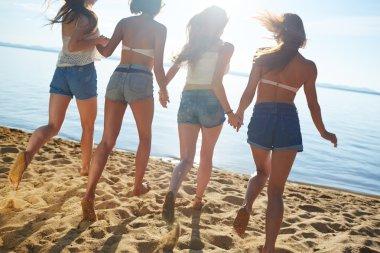 Girls in denim shorts