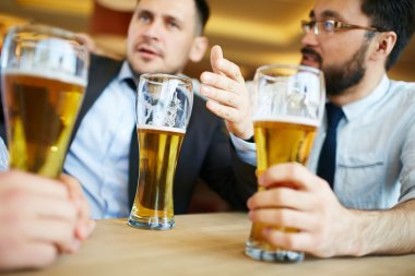Businessmen Talking and Drinking beer