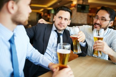 Group of businessmen drinking beer at pub