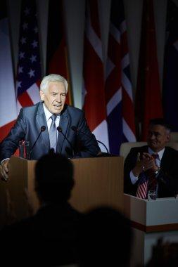 Mature politician speaking from tribune