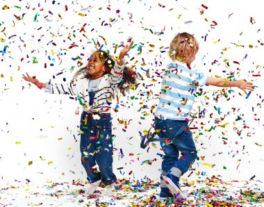 Happy children playing with confetti