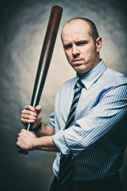 Furious gangster with baseball bat