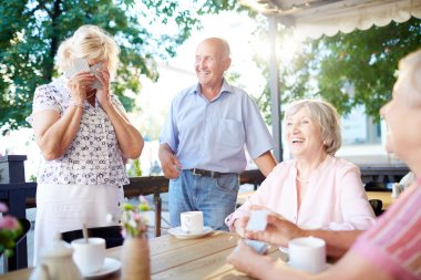 Laughing seniors spending leisure