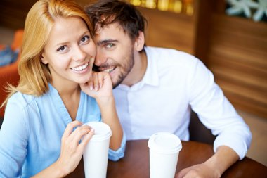 Young couple sitting in cafe